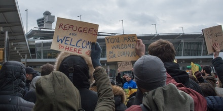 Protesters gather at JFK International Airport's Terminal 4 to demonstrate against US President Donald Trump's executive order, on January 28, 2016 in New York.Trump has signed a sweeping executive order to suspend refugee arrivals and impose tough controls on travellers from Iran, Iraq, Libya, Somalia, Sudan, Syria and Yemen. / AFP / Bryan R. Smith (Photo credit should read BRYAN R. SMITH/AFP/Getty Images)