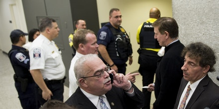 UNITED STATES - JANUARY 29: From left, Rep. Gerry Connolly, D-Va., speaks with a Customs and Border Patrol liaison on the phone as he along with Rep. Don Beyer, D-Va., and Rep. Jamie Raskin, D-Md., try to determine if any international travelers are detained without legal access at Dulles International Airport in Virginia on Sunday, Jan. 29, 2017. Protests erupted at airports around the country following President Trump's executive order restricting travel from several Islamic countries. (Photo By Bill Clark/CQ Roll Call)