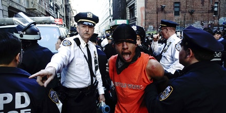 A demonstrator is arrested by police officers during a protest April 29, 2015 at Union Square in New York, held in solidarity with demonstrators in Baltimore, Maryland demanding justice for an African-American man who died of severe spinal injuries sustained in police custody.    AFP PHOTO/Eduardo Munoz Alvarez        (Photo credit should read EDUARDO MUNOZ ALVAREZ/AFP/Getty Images)