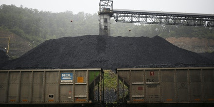 PRINTER, KY - JUNE 3:  Coal hoppers sit coupled on a spur track in front of a coal tower at Blackhawk Mining, LLC Spurlock Prep Plant on June 3, 2014 in Printer, Kentucky. New regulations on carbon emissions proposed by the Obama administration have reportedly angered politicians on both sides of the aisle in energy-producing states such as Kentucky and West Virginia.  (Photo by Luke Sharrett/Getty Images)