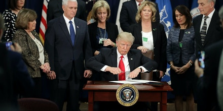 signs four executive orders during a visit to the Department of Homeland Security with Vice President Mike Pence, Homeland Security Secretary John Kelly and other officials in Washington, DC Donald Trump signs executive orders at the Department of Homeland Security, Washington DC, USA - 25 Jan 2017 Trump signed four executive orders related to domestic security and to begin the process of building a wall along the U.S.-Mexico border. (Rex Features via AP Images)