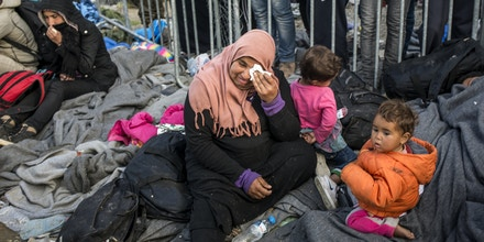 IDOMENI, GREECE, March 5, 2016--A woman cries as she and others wait for hours inside a police cordon, hoping to cross the border into FYROM Macedonia. Immigrants were exhausted and anxious after waiting nearly two weeks at the overcrowded Idomeni border camp, where nearly every day only a few hundred are permitted to cross to travel onward towards Western Europe.  (Photo by Jodi Hilton/NurPhoto) *** Please Use Credit from Credit Field ***