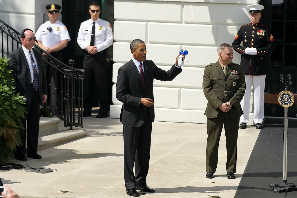 WASHINGTON - MAY 04:  U.S. President Barack Obama (C) blows the horn as he and Vice Chairman of the Joint Chiefs of Staff General James Cartwright (R) watch members of the Wounded Warrior Soldier Ride pass by as they ride on the ground of the White House May 4, 2011 in Washington, DC. Obama hosted the Wounded Warrior Soldier Ride to kick off their journey.  (Photo by Alex Wong/Getty Images)