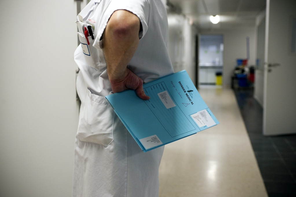 Photo Essay In Fleury Merogis Prison, France. November 2009. Care Centre Of Fleury Merogis Prison, In The Men Quarter. Male Nurse With The Medical File Of A Prisoner. (Photo By BSIP/UIG Via Getty Images)