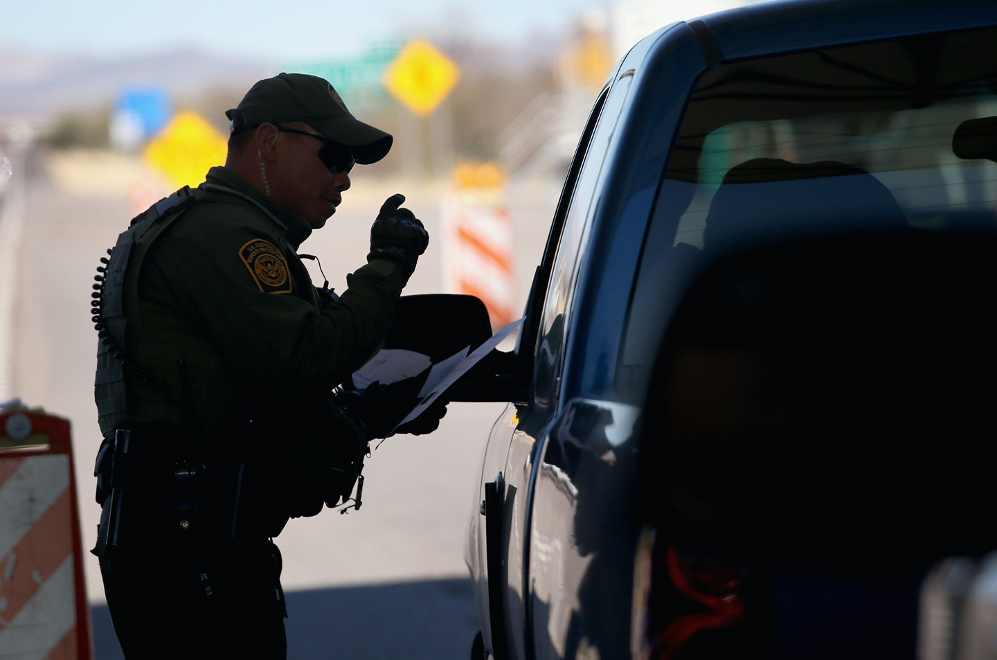 NOGALES, AZ - FEBRUARY 26:  A U.S. Border Patrol agent speaks to a driver at a checkpoint from Mexico into the United States on February 26, 2013 north of Nogales, Arizona. Some 15,000 people cross between Mexico and the U.S. each day in Nogales, Arizona's busiest border crossing. U.S. Customs and Border Patrol agents are tasked with stopping the illegal flow of drugs into the U.S. (Photo by John Moore/Getty Images)