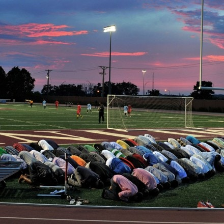 Somali Muslims pray during a soccer tournament in St. Paul, Minn.