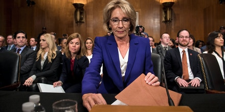 Betsy DeVos looks her papers over before her confirmation hearing for Secretary of Education before the Senate Health, Education, Labor, and Pensions Committee on Capitol Hill January 17, 2017 in Washington, DC. / AFP / Brendan Smialowski        (Photo credit should read BRENDAN SMIALOWSKI/AFP/Getty Images)