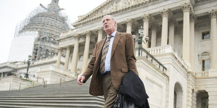 UNITED STATES - JANUARY 14: Sen. Dan Coats, R-Ind., makes his way to a bus that will take Republican senators to a retreat in Hershey, Pa., January 14, 2015. (Photo By Tom Williams/CQ Roll Call) (CQ Roll Call via AP Images)