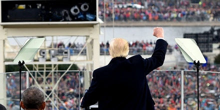 US President Donald Trump celebrates after his speech during the Presidential Inauguration at the US Capitol in Washington, DC, on January 20, 2017. / AFP / POOL / SAUL LOEB        (Photo credit should read SAUL LOEB/AFP/Getty Images)