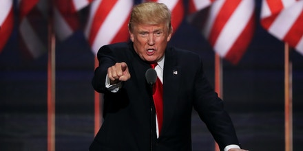 CLEVELAND, OH - JULY 21:  Republican presidential candidate Donald Trump points to the crowd as he delivers a speech during the evening session on the fourth day of the Republican National Convention on July 21, 2016 at the Quicken Loans Arena in Cleveland, Ohio. Republican presidential candidate Donald Trump received the number of votes needed to secure the party's nomination. An estimated 50,000 people are expected in Cleveland, including hundreds of protesters and members of the media. The four-day Republican National Convention kicked off on July 18.  (Photo by Alex Wong/Getty Images)