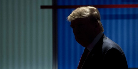 Donald Trump, president and chief executive of Trump Organization Inc. and 2016 Republican presidential candidate, walks on stage during a break in the Republican presidential candidate debate at the North Charleston Coliseum in North Charleston, South Carolina, U.S., on Thursday, Jan. 14, 2016. The sixth Republican debate comes at a time with less than three weeks before Iowa caucus-goers cast the first votes of the 2016 presidential election on February 1. Photographer: Andrew Harrer/Bloomberg via Getty Images