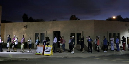 FILE - In this Nov. 8, 2016, file photo, voters wait for the polls to open at dawn in Phoenix. The county official who took the blame for hours-long lines that plagued this year's presidential primary in Arizona was dumped from office amid widespread frustration among voters over the bungled election. Republican Helen Purcell conceded on Tuesday, Nov. 15, to Democrat Adrian Fontes in the Maricopa County recorder's race. The county was still tallying ballots but she was nearly 13,000 votes behind when she acknowledged the loss. (AP Photo/Matt York, File)