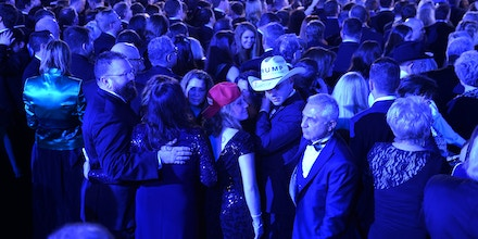 Attendees await the arrival of US President Donald Trump at the Freedom Inaugural Ball, January 20, 2017, in Washington, DC. / AFP / Robyn Beck        (Photo credit should read ROBYN BECK/AFP/Getty Images)