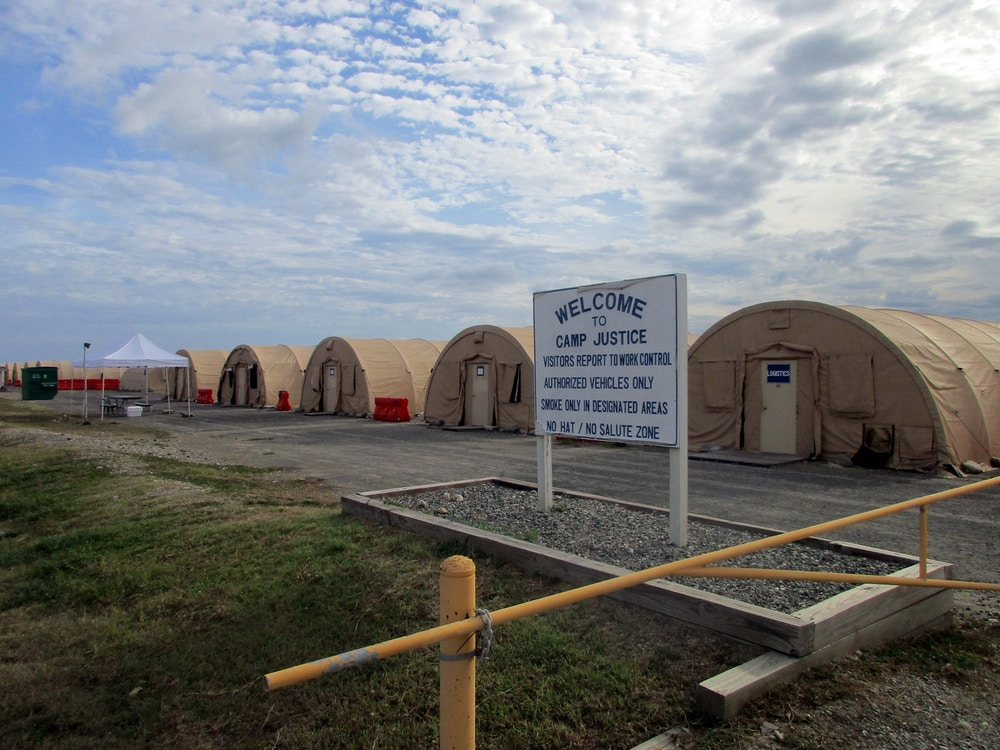 CORRECTS NAME OF FACILITY AND DATE PHOTO TAKEN - This June 2016 photo shows the exterior of Camp Justice at the U.S. Naval base at Guantanamo Bay, Cuba. There are now 59 prisoners at Guantanamo, down from 242 when President Barack Obama took office. Of those who remain, 22 are cleared for release and some are expected to be transferred out in the final weeks of the administration. Congress has barred moving them to facilities in the United States for any reason, including trial, so they are otherwise stuck at the base. (AP Photo/Ben Fox)