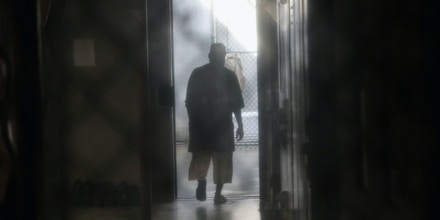 GUANTANAMO BAY, CUBA - OCTOBER 22: (EDITORS NOTE: Image has been reviewed by the U.S. Military prior to transmission.)   A prisoner walks to an outdoor area of the