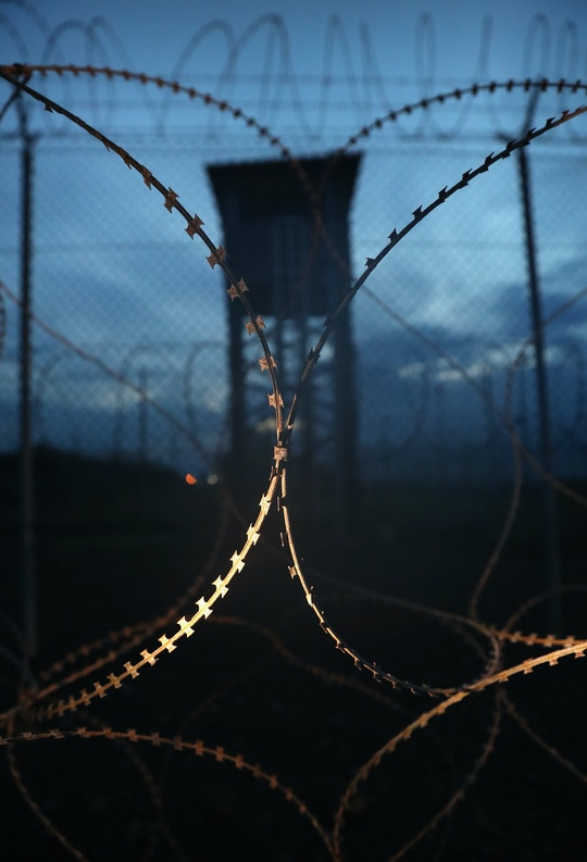 "GUANTANAMO BAY, CUBA - OCTOBER 22: (EDITORS NOTE: Image has been reviewed by the U.S. Military prior to transmission.) Razor wire and a guard tower stands at a closed section of the U.S. prison at Guantanamo Bay, also known as ""Gitmo"" on October 22, 2016 at the U.S. Naval Station at Guantanamo Bay, Cuba. The U.S. military's Joint Task Force Guantanamo is holding 60 detainees at the prison, down from a previous total of 780. In 2008 President Obama issued an executive order to close the prison, which has failed because of political opposition in the U.S.  (Photo by John Moore/Getty Images)"