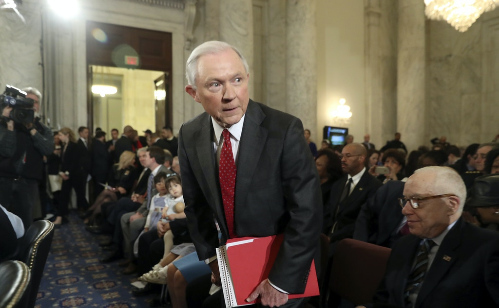 Attorney General-designate, Sen. Jeff Sessions, R-Ala., takes his seat on Capitol Hill in Washington, Tuesday, Jan. 10, 2017. where he was to testify at his confirmation hearing before the Senate Judiciary Committee. Former Attorney General Michael Mukasey is at right.  (AP Photo/Andrew Harnik)