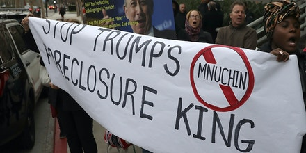 Protesters hold a sign during a demonstration outside of a Goldman Sachs office on Jan. 18, 2017 in Los Angeles. More than two dozen activists and foreclosure victims staged a demonstration outside of a Goldman Sachs office to denounce Steve Mnuchin, President-elect Donald Trump's Treasury Secretary nominee.