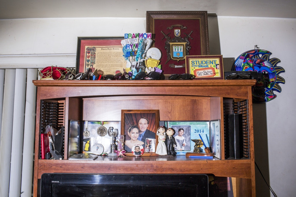 TIJUANA, MX. - APRIL 7 2016:  A portrait of Sanchez-Paulsen's family on a shelf in the living room of her Tijuana home. Natalie Keyssar