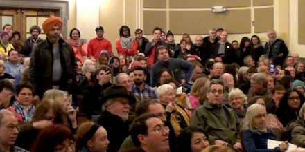 This still frame made from video footage shows attendees at a town hall held by Sen. Sheldon Whitehouse, D-R.I., where more than one thousand people showed up at the senator's town hall, held inside a Providence middle school auditorium, to denounce Whitehouse's support for Mike Pompeo.