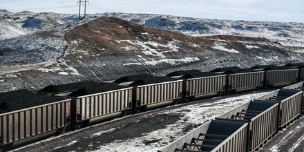 FILE - In this Jan. 9, 2014, file photo, rail cars are filled with coal and sprayed with a topper agent to suppress dust at Cloud Peak Energy's Antelope Mine north of Douglas, Wyo. The U.S. Interior Department is poised to move forward with consideration of two mining projects totaling 644 million tons of coal beneath public lands, after a panel recommended proceeding with the applications despite a recent moratorium halting federal coal sales Wednesday, Jan. 27, 2016. The unanimous vote by officials from Wyoming, Montana and Interior's Bureau of Land Management clears the way for a multi-year evaluation of the projects.  (Ryan Dorgan/Casper Star-Tribune via AP, File)