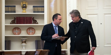 WASHINGTON, DC - JANUARY 28: (L to R) White House Chief of Staff Reince Priebus speaks with White House Chief Strategist Steve Bannon as President Donald Trump speaks on the phone with Chancellor of Germany Angela Merkel in the Oval Office of the White House, January 28, 2017 in Washington, DC. On Saturday, President Trump is making several phone calls with world leaders from Japan, Germany, Russia, France and Australia. (Photo by Drew Angerer/Getty Images)