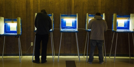 MILWAUKEE, WI - NOVEMBER 8: Voters cast their ballot in the national election at Cannon Pavilion on November 8, 2016 in Milwaukee, Wisconsin. Americans are headed to the polls to vote for either Republican presidential candidate Donald Trump or Democratic presidential candidate Hillary Clinton and other members of Congress.  (Photo by Darren Hauck/Getty Images)