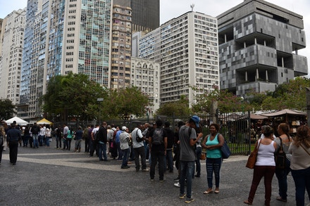 Unemployed people queue to registrate to search for jobs in downtown Rio de Janeiro, Brazil on May 25, 2016.<br /><br /><br /><br /><br /><br /><br /><br /><br /><br /><br /><br /><br /><br /><br /><br /><br /><br /><br /> According to the last survey, the unemployment rate has raised to 10.78%, the highest in the last years Brazil, as a strong economic crisis and corruption scandals hit the country. / AFP / VANDERLEI ALMEIDA        (Photo credit should read VANDERLEI ALMEIDA/AFP/Getty Images)