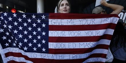 LOS ANGELES, CA - JANUARY 29: Chella, from Sherman Oaks, holds the U.S. flag with words from the sonnet,