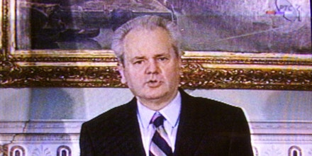 Yugoslav President Slobodan Milosevic delivers March 24 a nationwide television address. Milosevic said his government was right to reject foreign troops in Kosovo and urged Yugoslavs to stand firm against possible NATO air strikes.RS//ME - RTRN932