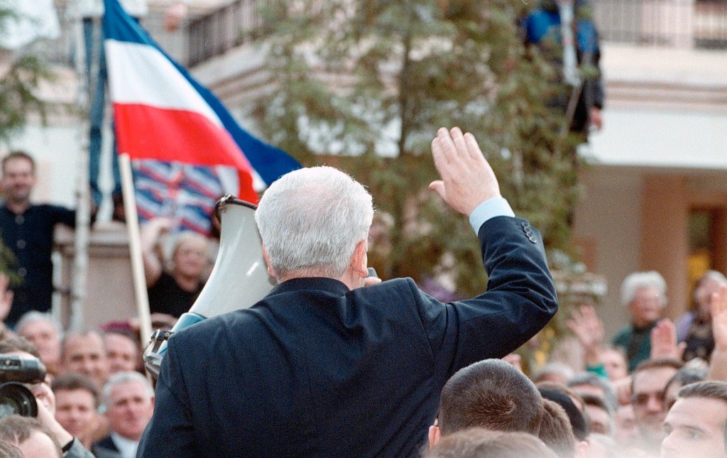 387109 05: Former Yugoslav President Slobodan Milosevic is greeted by supporters in front of his house in Belgrade, Yugoslavia, during a gathering of the Socialist Party of Serbia (SPS) for an anti-Nato rally, March 24, 2001. The rally marked the second anniversary of the NATO bombing that was launched to stop Milosevic's crackdown on separatist ethnic Albanians in the Kosovo province. (Photo by Couple/Globalphoto.com/Liaison) (AMERICAS SALES ONLY)