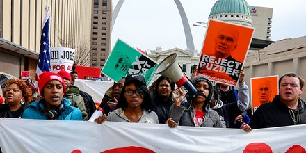ST LOUIS, MO - FEBRUARY 13: Protesters walk to a Hardee's restaurant during a rally against Andrew Puzder's nomination for labor secretary near the Hardee's Headquarters on February 13, 2017 in St Louis, Missouri. The protesters feel that Mr. Puzder will not have the best interest of workers in mind due to his record of being a critic of raising the minimum wage as well as expansion of overtime pay, paid sick leave and the Affordable Care Act.   (Photo by Jeff Curry/Getty Images)