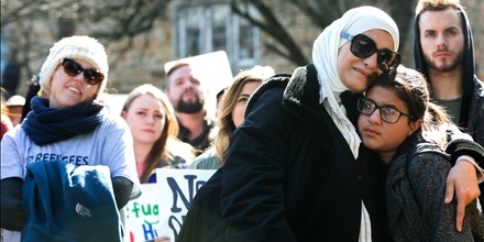 ATLANTA, GA - FEBRUARY 04: Palestinian immigrant and American citizen Kareema Sabdah (left) hugs her daughter, Jenna, 13, during an Interfaith Rally for Muslims and Refugees at the Lutheran Church of the Redeemer on February 4, 2017 in Atlanta, Georgia. Hundreds of activists gathered in Atlanta to protest President Trump's immigration ban. (Photo by Jessica McGowan/Getty Images)