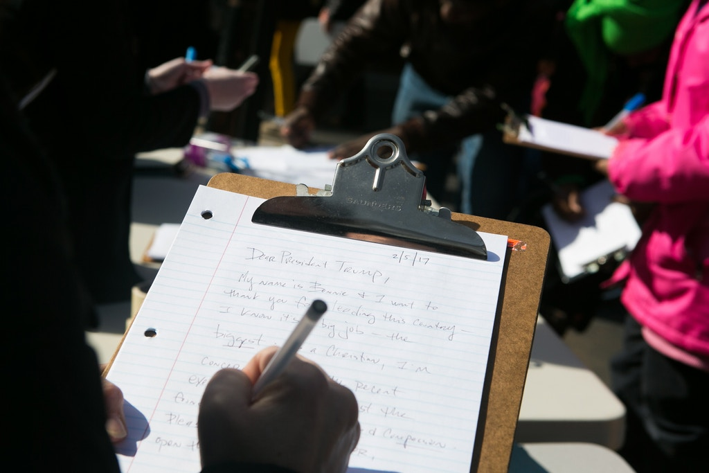 ATLANTA, GA - FEBRUARY 04: Protestors write letters to President Trump in opposition to his Immigration Ban during an Interfaith Rally for Muslims and Refugees at the Lutheran Church of the Redeemer on February 4, 2017 in Atlanta, Georgia. Hundreds of activists gathered in Atlanta to protest President Trump's immigration ban. (Photo by Jessica McGowan/Getty Images)