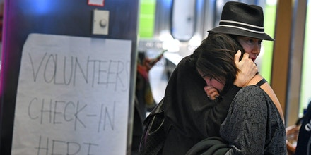 A woman of Iranian descent (R) cries as she waits for a family member after the immigration ban imposed by U.S. President Donald Trump at the Los Angeles International Airport, California on January 30, 2017.Trump's executive order suspended the arrival of all refugees for at least 120 days, Syrian refugees indefinitely -- and bars citizens from Iran, Iraq, Libya, Somalia, Sudan, Syria and Yemen for 90 days. Protests are taking place at airports across the country in opposition to the ban. / AFP / Mark RALSTON (Photo credit should read MARK RALSTON/AFP/Getty Images)