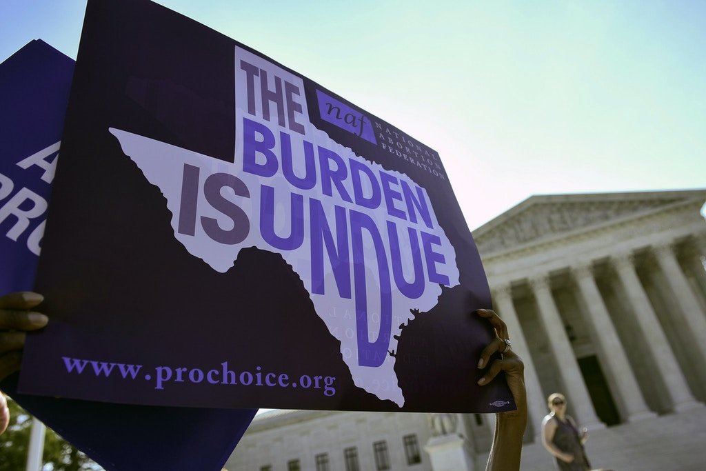 "An abortion rights activist holds placards outside of the US Supreme Court before the Court struck down a Texas law placing restrictions on abortion clinics on June 27, 2016 in Washington, DC.The US Supreme Court on Monday struck down a Texas law placing a raft of restrictions on abortion clinics, handing a major victory to the ""pro-choice"" camp in the country's most important ruling on the divisive issue in a generation. / AFP / MANDEL NGAN (Photo credit should read MANDEL NGAN/AFP/Getty Images)"