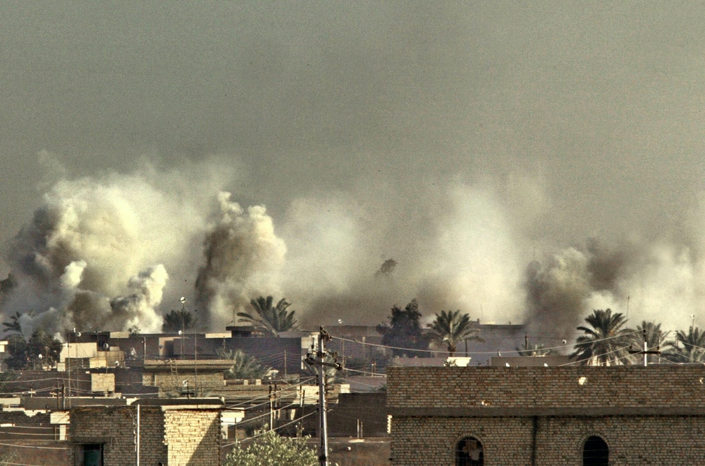 FALLUJAH, IRAQ:  Smoke billows from US targeted areas in the restive Sunni Muslim Iraqi city of Fallujah 11 November 2004, west of Baghdad. US forces aim to control all of Fallujah in two days time despite fierce fighting as they push deeper, an officer said, adding that they already command 75 percent of the rebel Iraqi enclave.   AFP PHOTO/PATRICK BAZ  (Photo credit should read PATRICK BAZ/AFP/Getty Images)