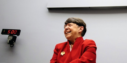 Mary Jo White, chairman of the U.S. Securities and Exchange Commission (SEC), smiles before testifying at a House Financial Services Committee hearing in Washington, D.C., U.S., on Thursday, May 16, 2013. White rebuffed calls by House Republicans to forswear a rule that would force public companies to disclose political spending, saying she won't