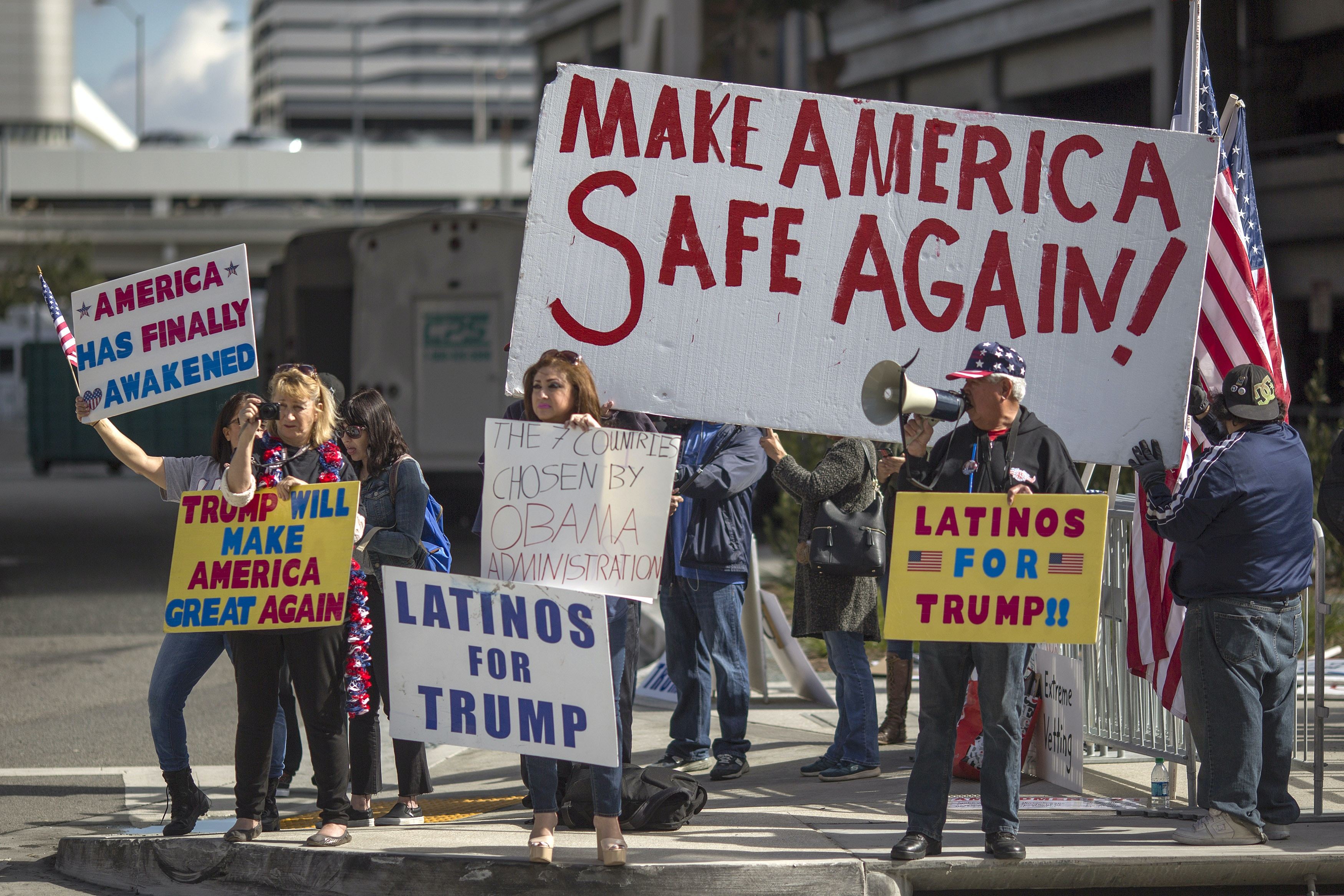 LOS ANGELES, CA - FEBRUARY 04: Trump supporters demonstrate against a ruling by a federal judge in Seattle that grants a nationwide temporary restraining order against the presidential order to ban travel to the United States from seven Muslim-majority countries, at Tom Bradley International Terminal at Los Angeles International Airport on February 4, 2017 in Los Angeles, California. (Photo by David McNew/Getty Images)
