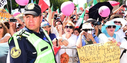 Crowds participate in The Citizen's March for the Respect of Mexico (la Marcha Ciudadana por el Respeto para México), a peaceful protest to both celebrate the pride of being Mexican, and to