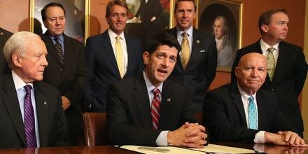 WASHINGTON, DC - MAY 18:  House Speaker Paul Ryan (D-WI), (C), speaks before signing the American Manufacturing Competitiveness Act of 2016, while flanked by (seated), Ways and means Committee Chairman Kevin Brady (R-TX), (R), and Senate Finance Committee Chairman Orrin Hatch (R-UT), (L), along with other members of Congress, on Capitol Hill May18, 2016 in Washington, DC.  (Photo by Mark Wilson/Getty Images)
