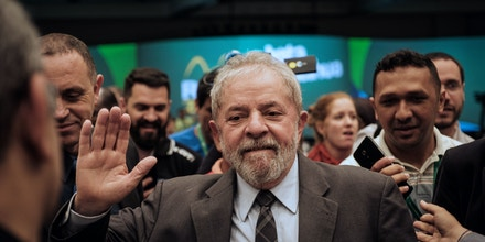 Brazil's former president (2003-2011) Luiz Inacio Lula da Silva waves during the second congress of the IndustriALL Global Union in Rio de Janeiro, Brazil on October 4, 2016.IndustriALL Global Union represents workers in the mining, energy and manufacturing sectors in 140 countries around the world. / AFP / YASUYOSHI CHIBA (Photo credit should read YASUYOSHI CHIBA/AFP/Getty Images)