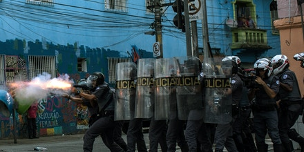 SAO PAULO, BRAZIL - FEBRUARY 23:  Military tactical police officers advance on suspected drug users in the region known as