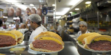Workers make mortadella sandwiches at a cafeteria in the municipal market in Sao Paulo, Brazil, March 15, 2010 in Brazil.   AFP PHOTO/ANTONIO SCORZA (Photo credit should read ANTONIO SCORZA/AFP/Getty Images)