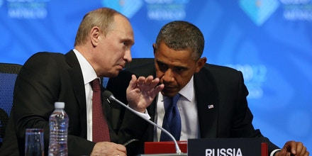 U.S. President Barack Obama, right, listens to Russia's President Vladimir Putin before the opening of the first plenary session of the G-20 Summit in Los Cabos, Mexico, Monday, June 18, 2012. (AP Photo/Andres Leighton)