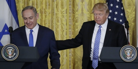 President Donald Trump and Israeli Prime Minister Benjamin Netanyahu arrive for a joint news conference in the East Room of the White House in Washington, Wednesday, Feb. 15, 2017. (AP Photo/Evan Vucci)