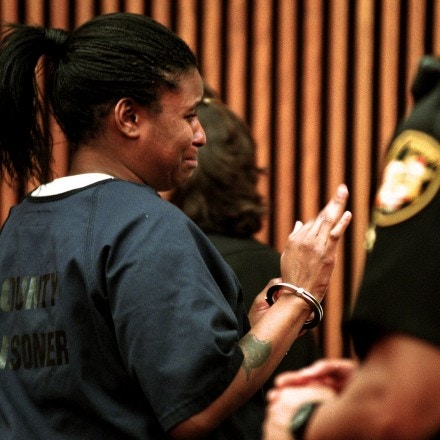 Angela Garcia waves goodbye to her family as she is lead out of Judge Bridget M. McCafferty's court room June8, 2000 by Cuyahoga County Sherrifs deputies.  Garcia lost her bid for a reduction in bail hearing.  (John Kuntz/Plain Dealer)