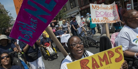 NEW YORK, NY - JULY 12: People participate in the first annual Disability Pride Parade on July 12, 2015 in New York City. The parade calls attention to the rights of people with disabilities and coincides with the 25th anniversary of the Americans with Disabilities Act. (Photo by Stephanie Keith/Getty Images)