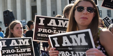 Anti-abortion activists hold placards before a US Supreme Court ruling on a Texas law placing restrictions on abortion clinics, outside of the Supreme Court on June 27, 2016 in Washington, DC.In a case with far-reaching implications for millions of women across the United States, the court ruled 5-3 to strike down measures which activists say have forced more than half of Texas's abortion clinics to close. / AFP / MANDEL NGAN (Photo credit should read MANDEL NGAN/AFP/Getty Images)