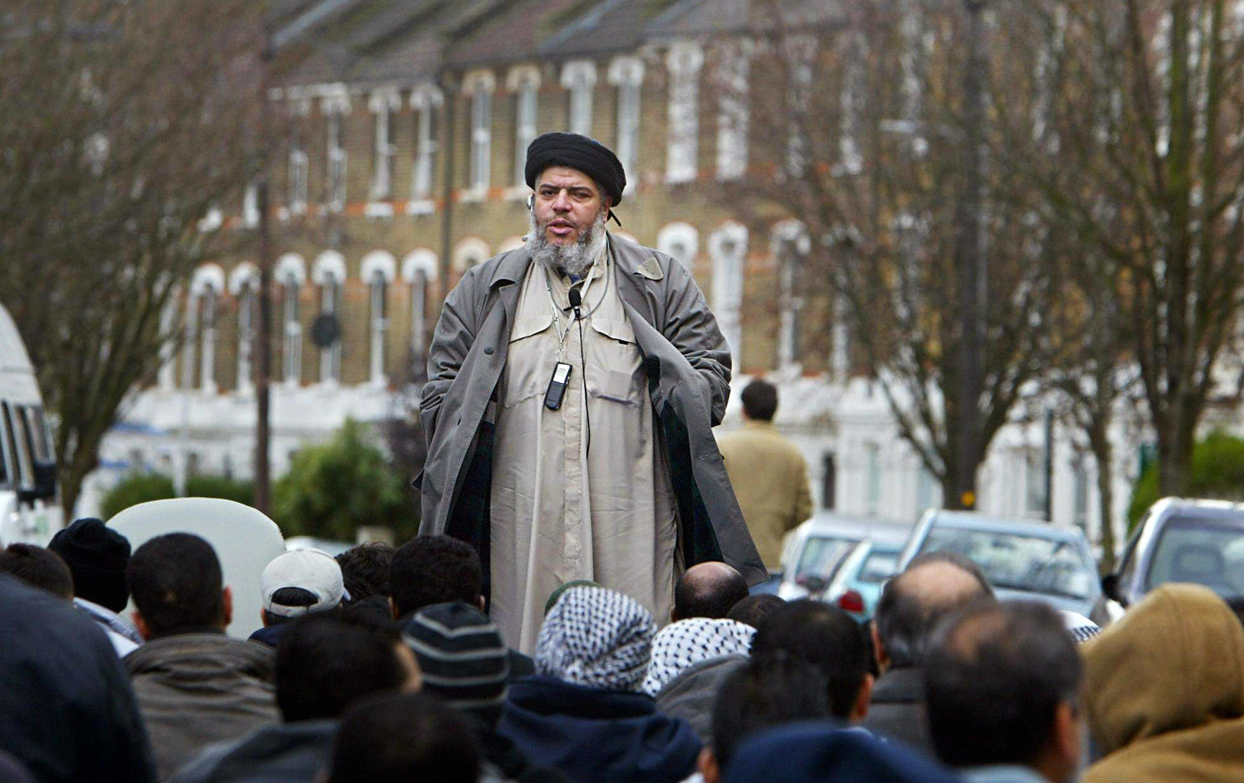 "LONDON, United Kingdom:  (FILES) Imam Abu Hamza al-Masri addresses followers during Friday prayer in near Finsbury Park mosque in north London, in this 26 March 2004 file photo. Hamza al-Masri was found guilty Tuesday 07 February 2006 of incitement of racial hatred and soliciting murder charges after a criminal trial in London. Hamza, 47, was convicted of six out of nine soliciting-to-murder charges and two out of four charges of ""using threatening, abusive or insulting words or behaviour with the intention of stirring up racial hatred"".AFP PHOTO/ODD ANDERSEN/FILES  (Photo credit should read ODD ANDERSEN/AFP/Getty Images)"